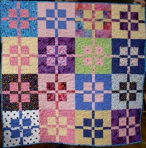 This is a slight variation on Birthday Presents, by Atkinson Designs; it made a great baby quilt