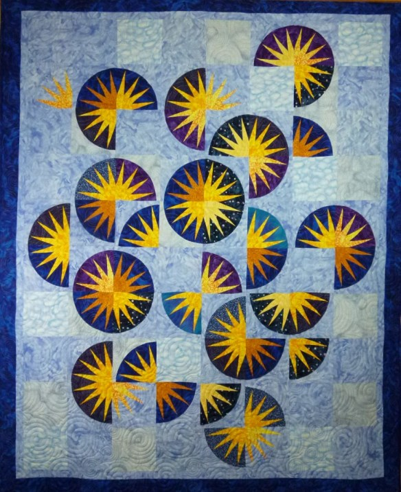 Spring Sun, a design by me, using blocks paper pieced from a totally different Judy Niemeyer pattern!