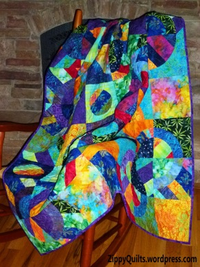 This is made with bright batiks and templates from Elisa's Backporch Design