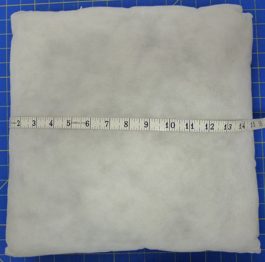 Measure pillow form for quilted pillow