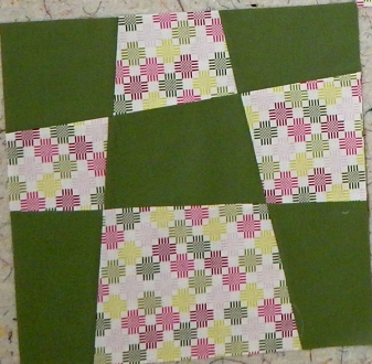 Pink and green orphan blocks need to be made into a donation quilt