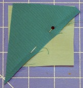 Pin triangle where you plan to sew it