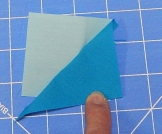 Flip triangle over the pin to be sure it will cover the corner