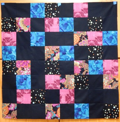 Pseudo Random arrangement starting with Kaffe fabric