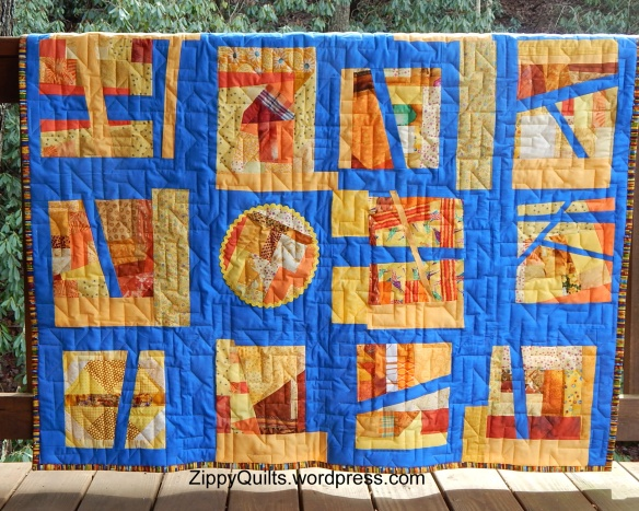 Improvisational quilt, orange and blue quilt
