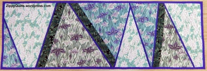 This is one of the samples for my table runner class, and includes my narrow inserts to define some of the sections