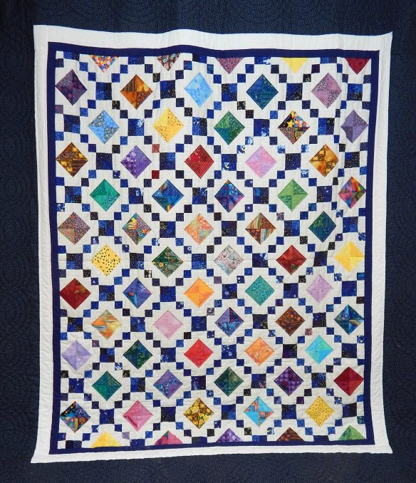 Queen size quilt made by qultl-as-you-go method