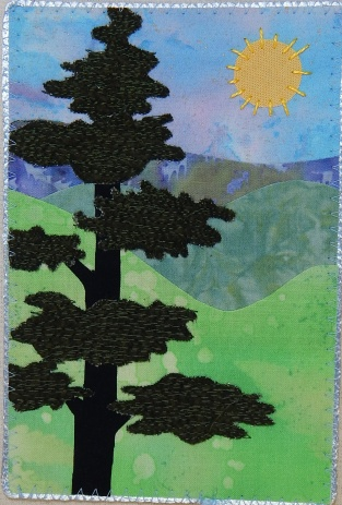 This pine tree has green flannel for foliage and lots of free motion quilting for texture
